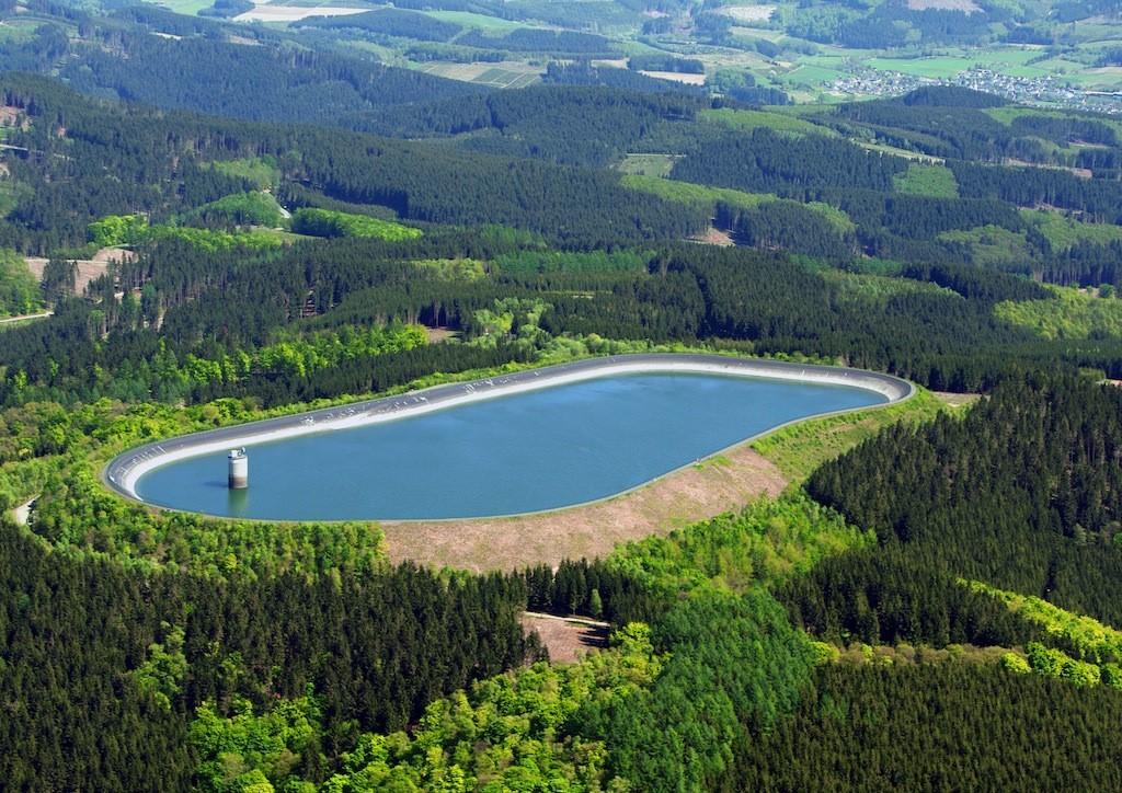 Storage dam surrounded by forests