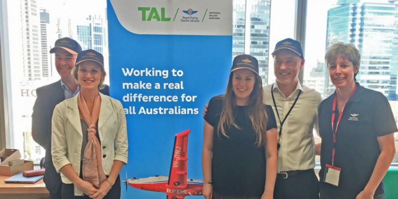 RFDS staff in front of TAL banner