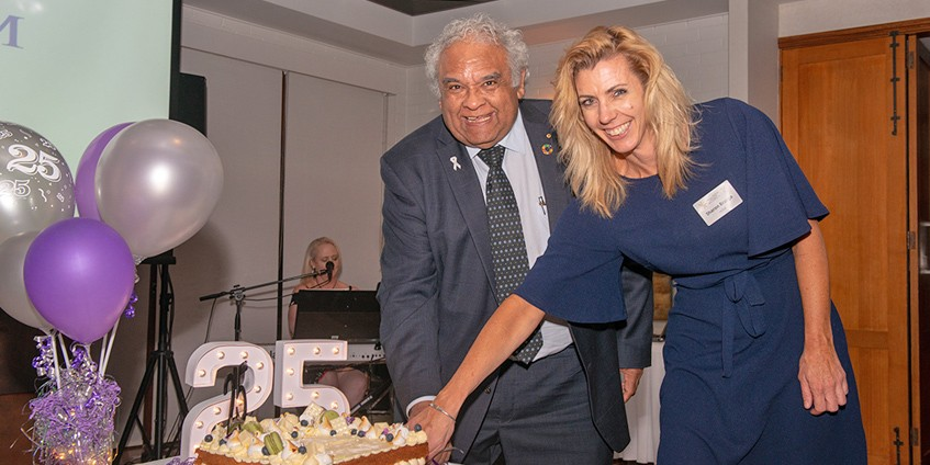 Keynote speaker, Professor Tom Calma, and sponsor HESTA's Sharon Brugza, cut the cake to celebrate the National Rural Health Alliance's 25th anniversary