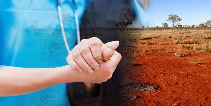 Medical practictioner holding older persons hand with outback image