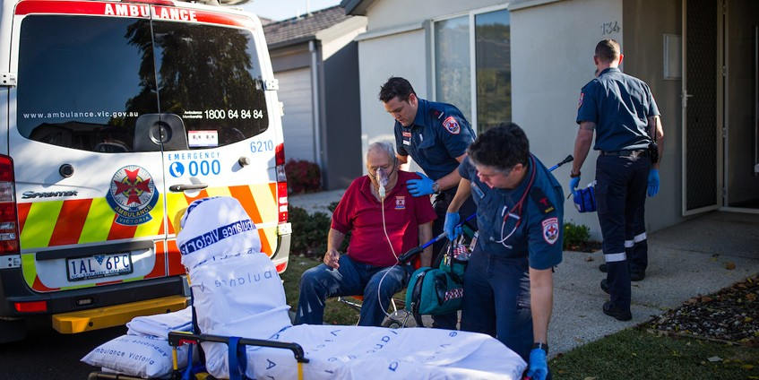 Paramedics with older male patient