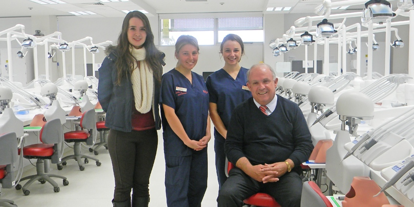 Scholarship recipients Amelia Judson (2013), Alayne White (2012) and Jessica Powell (2011) with Senator John Williams when he visited Charles Sturt University, Orange, in 2013