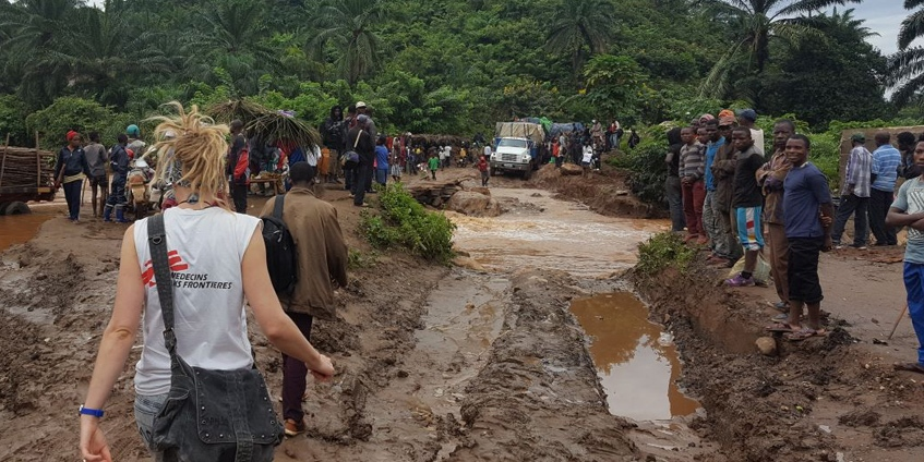 Lisa Searle crossing muddy roads in Baraka