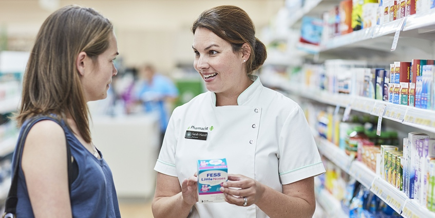 female pharmacy staff with customer
