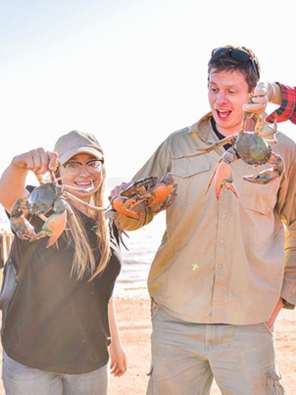 Jessica Watson, Tom Godfrey and Annabel Marshall mud crabbing in Derby