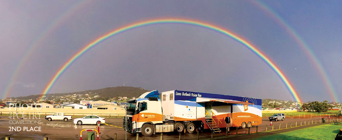Sharon Brown - The Lions Outback Vision Van's very first trip to Albany in her inaugural year 2016. Although overcast and raining, the sun managed to burst through and create a double rainbow that appeared to encompass the mobile opthalmic facility.<br />Pictured outside the van is Professor Angus Turner who is the entrepreneurial eye consultant behind the inception of the twenty metre mobile clinic.