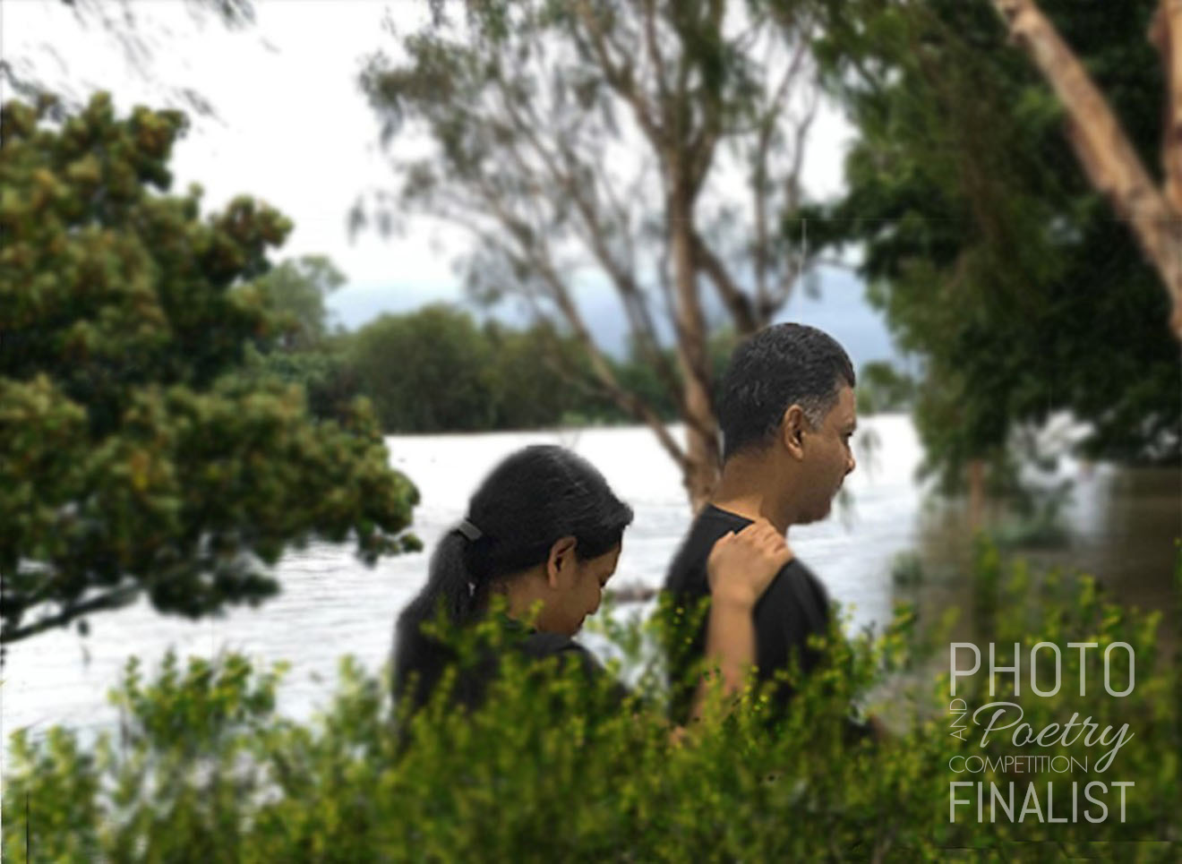 Townsville flooding - In the wrath of Townsville flooding, this photo captures the beauty of a couple trying to walk in the floods. ANKIT GOYAL, Garbutt, QLD