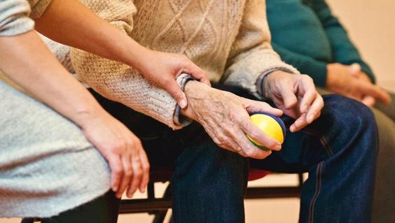 older man holding ball