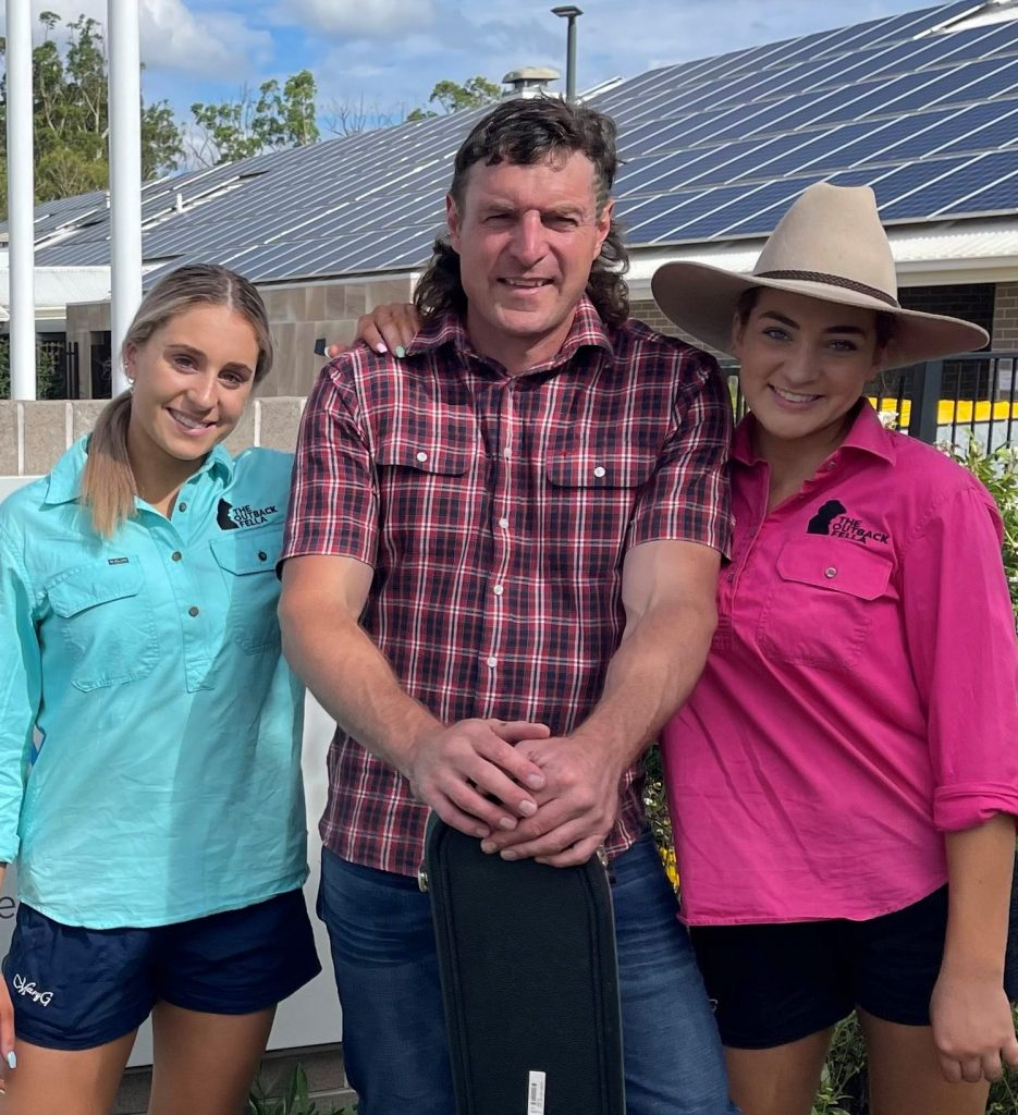 Josh Arnold and his daughters