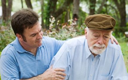 Man helping older man